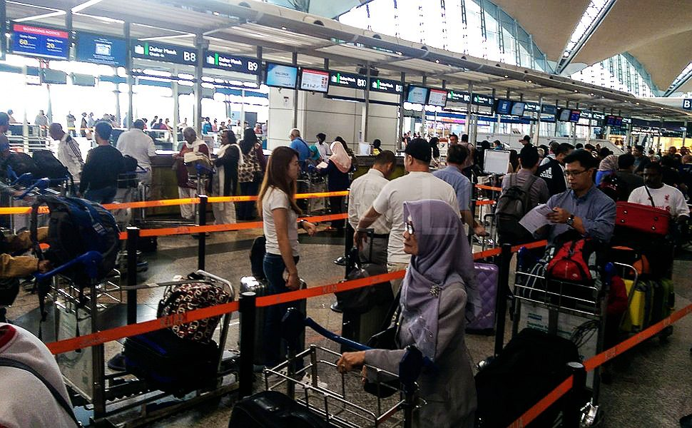 Passengers lining up for the check-in counters at KLIA