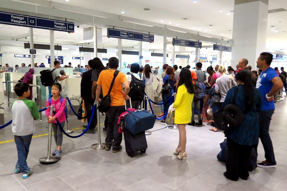 Passengers queuing up for the Immigration checks