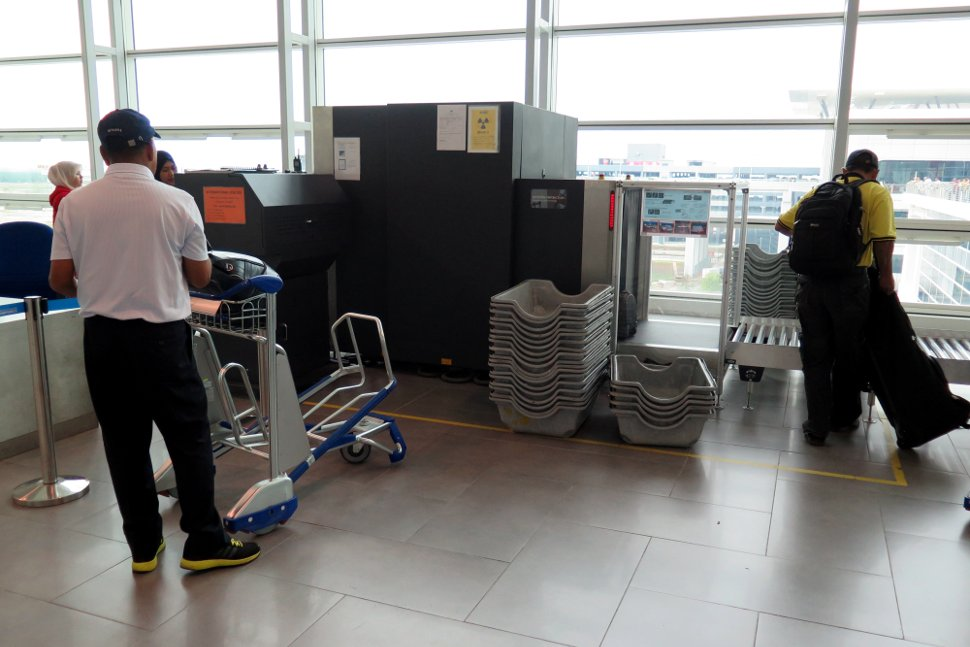 Passengers loading the oversize baggage at the Departure Hall