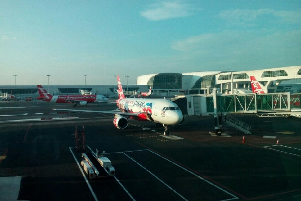 View of AirAsia's flights from the gate J