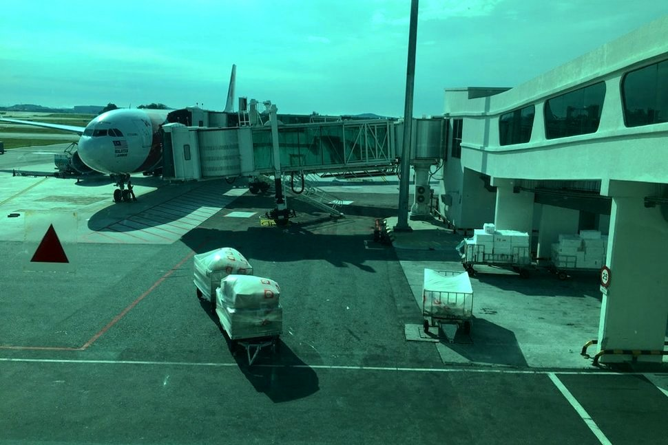 View of AirAsia flight connected to Aerobridge from the Pier