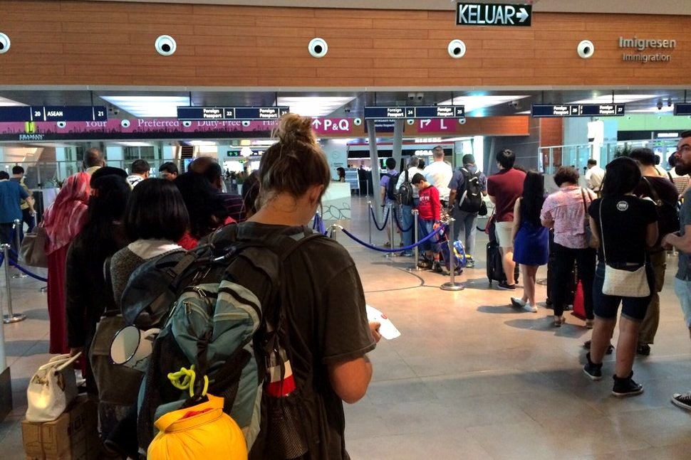 Passengers queuing up for document check at the Immigration counters