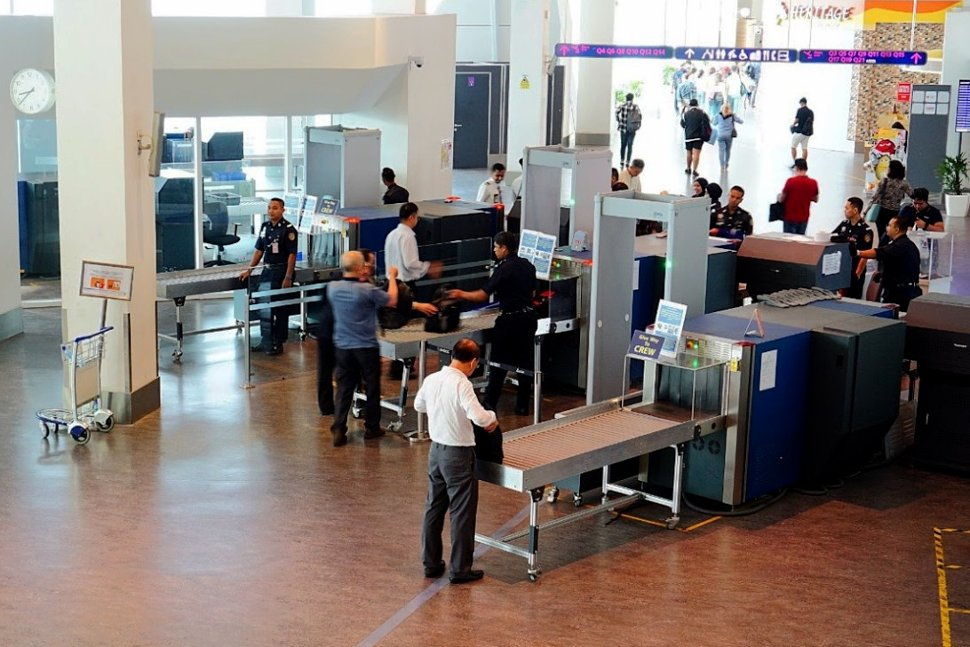 Officers conducting security check at the klia2's Pier