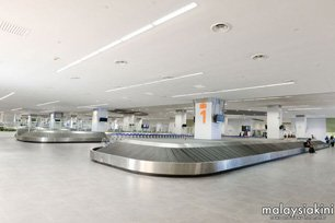 Baggage Claim area - Picture by malaysiakini