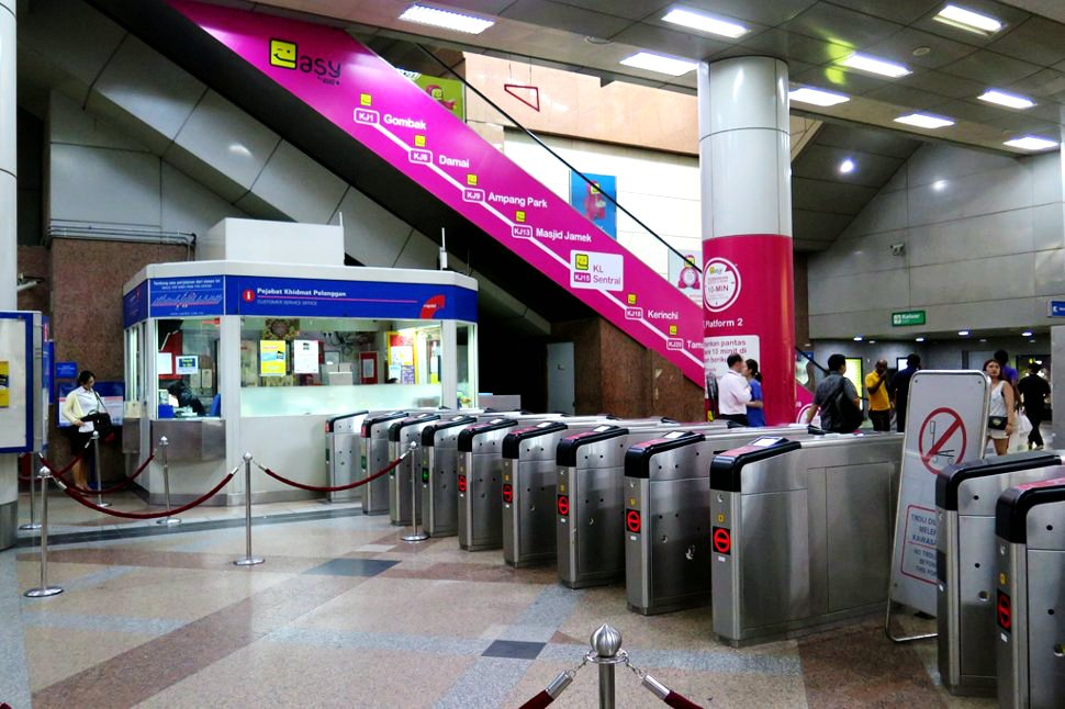 Ticket counter, entrance gates, and escalator access