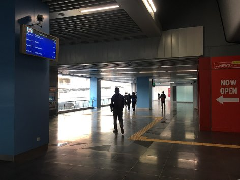 Commuters headed towards Entrance B of the station