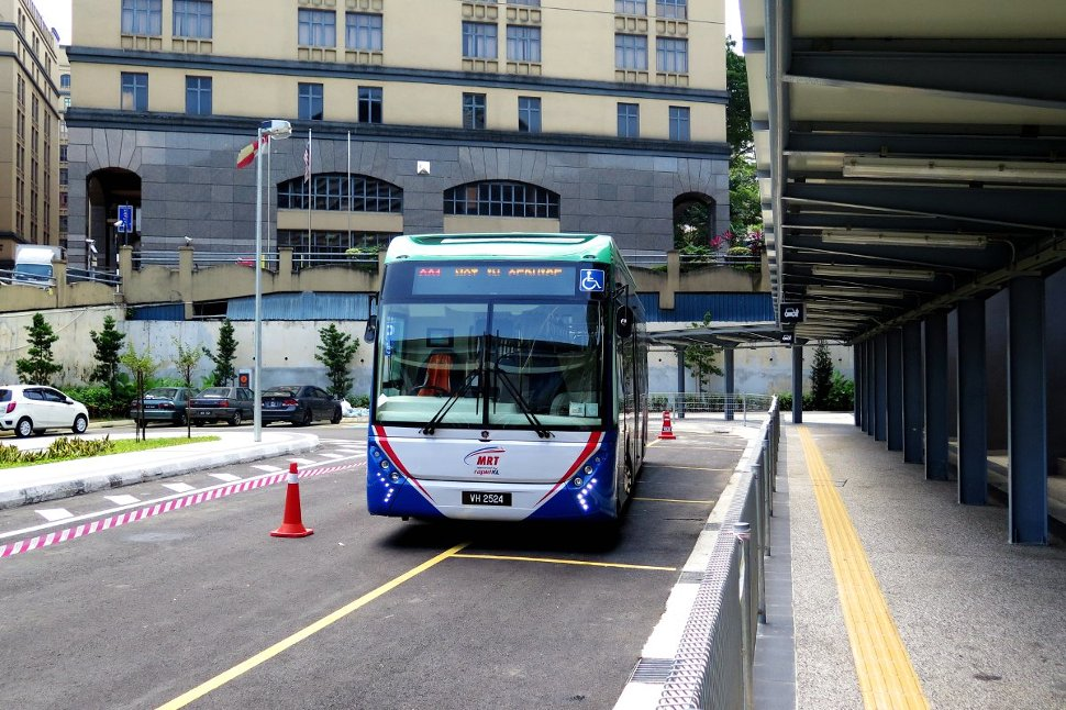Feeder bus lining up near the entrance A