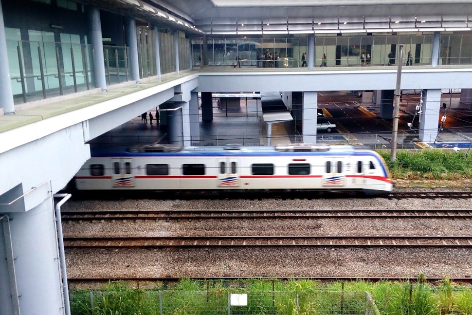 KTM train passing through the KTM Komuter station