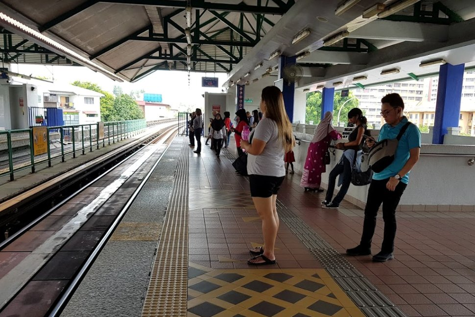Commuters waiting at boarding platform